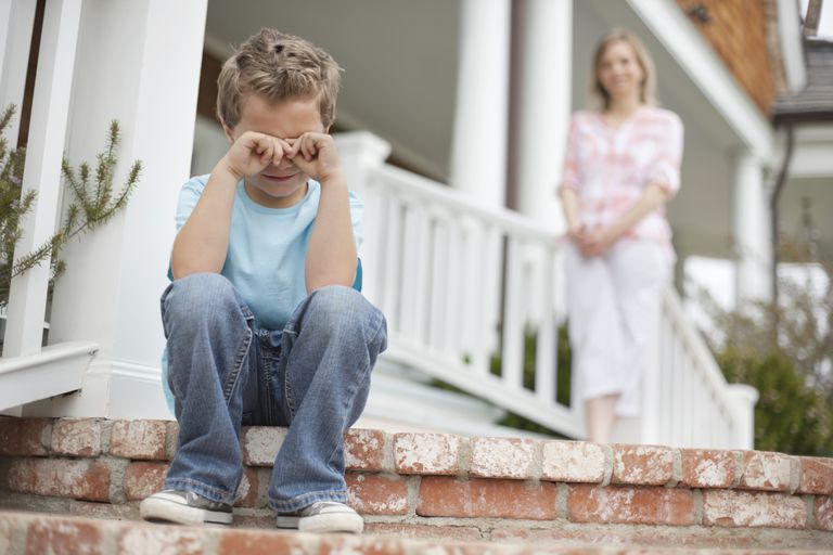 Boy Crying on Steps of Home