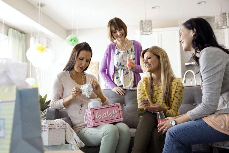Female friends celebrating baby shower