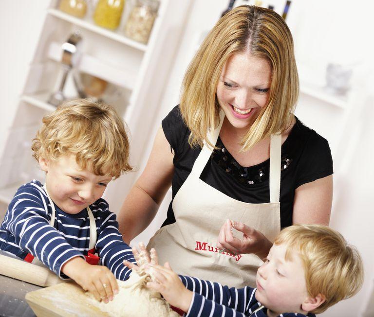 Portrait Of Family Enjoying Cooking