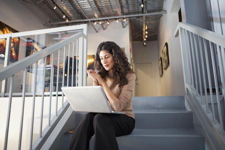 woman on laptop in art gallery