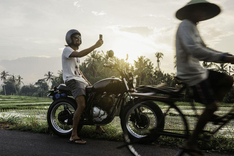 Man selfie-ing on Bali road