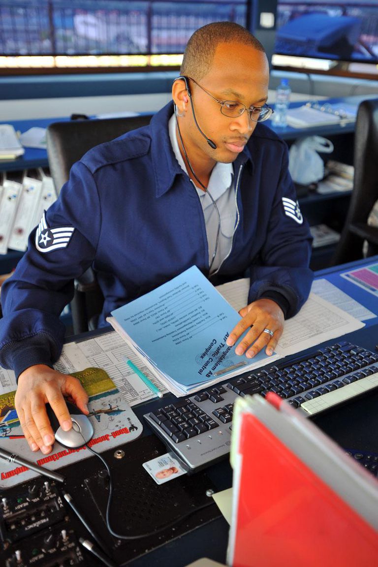 U.S. Air Force Staff Sgt. Reginald Joseph fills out forms and checklists Aug. 1, 2011, inside the control tower at Spangdahlem Air Base, Germany. Joseph is an air traffic controller assigned to the 52nd Operations Support Squadron.