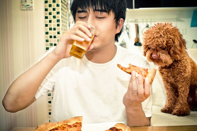 man consuming alcohol