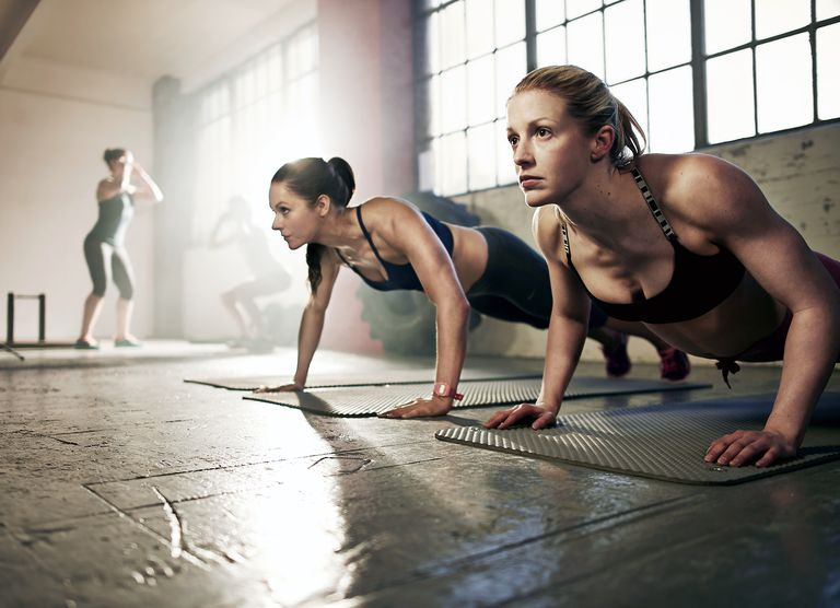 Group of strong women working out in gym