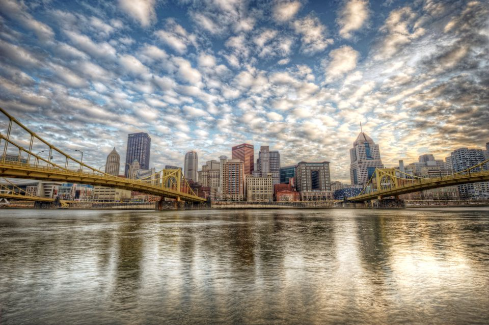 Pittsburgh skyline with bridges and clouds
