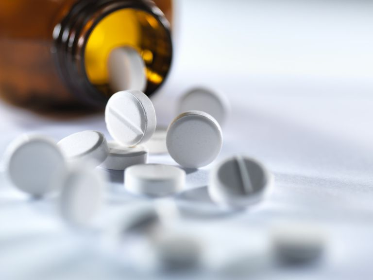 Pills Spilling From a Bottle