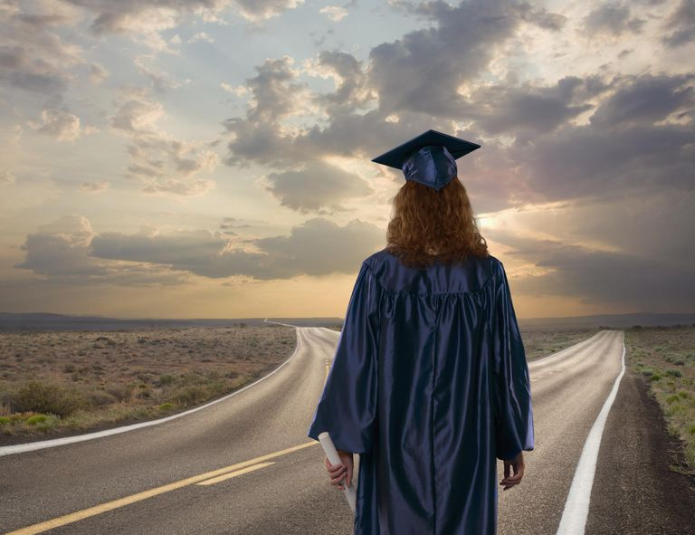 Graduate standing at crossroads