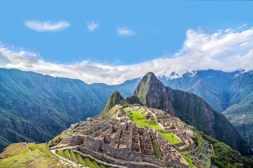 Scenic View Of Machu Picchu Against Blue Sky