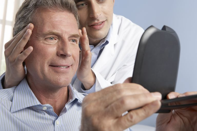 plastic surgeon consulting with patient