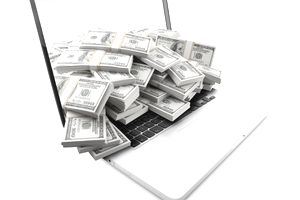 Isolated modern laptop with lots of dollar money overflow