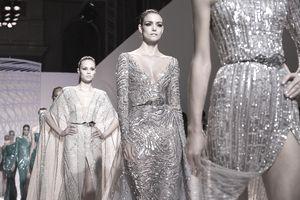 Models walk the runway during Paris Fashion Week