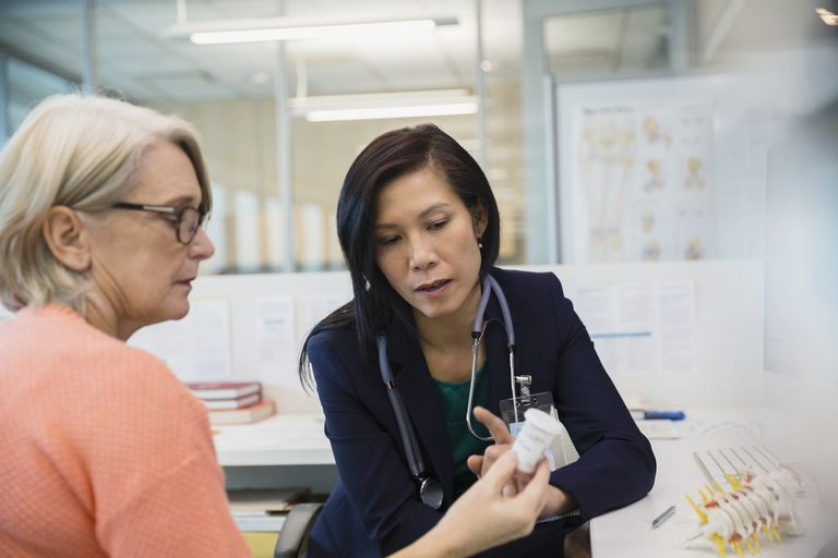 Doctor explaining prescription medication to patient in clinic