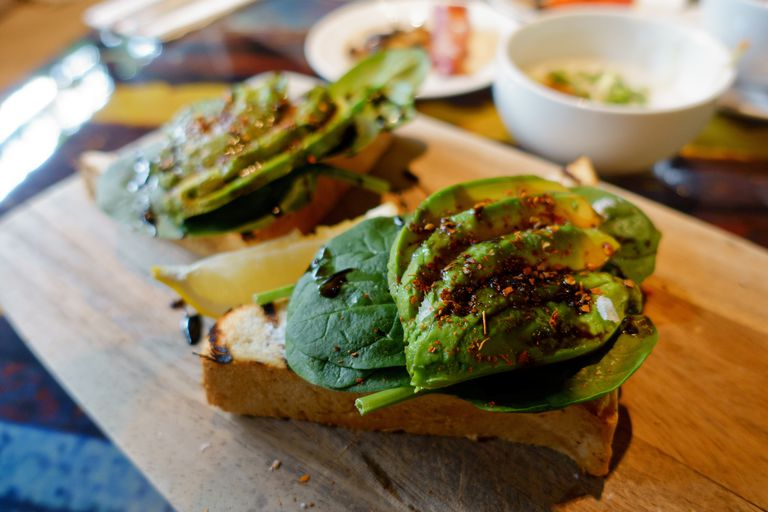 Close-Up Of Open Sandwiches Served On Cutting Board