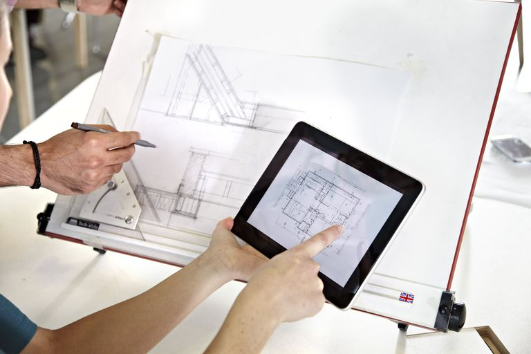 hands pointing to a floor plan on a digital tablet with architectural drawings being modified - Floor Plan Tools