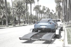 Sports Car Being Towed