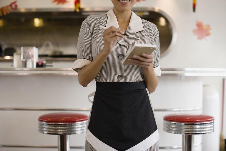 Asian waitress taking order