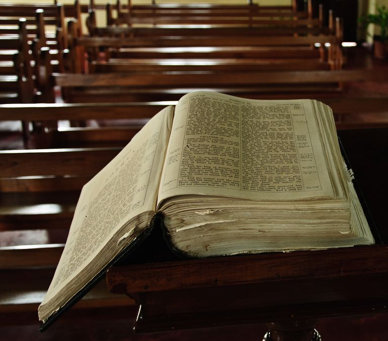 Do you have the spiritual gift of healing high angle view of bible on pew at church negle Images