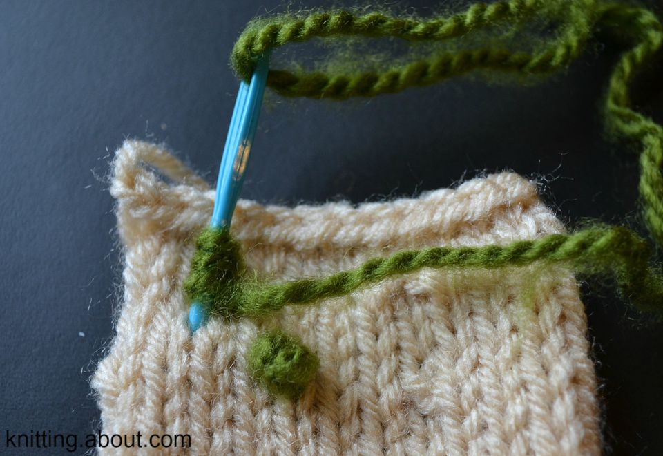 French knots are a fun and easy way to add color after the knitting is done.