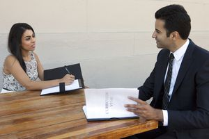 Woman interviewing man for a job