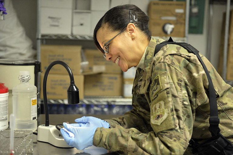 U.S. Air Force Lt. Col. Miriam Montes, a flight commander, cross-matches blood to determine its type and compatibility in the lab at Craig Joint Theater Hospital at Bagram Airfield in Parwan province, Afghanistan, March 18, 2014.