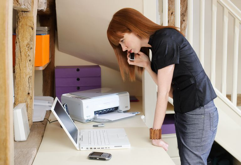 Young business woman using mobile in home office