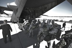 U.S. Airmen assigned to the 820th Rapid Engineer Deployable Heavy Operational Repair Squadron Engineer