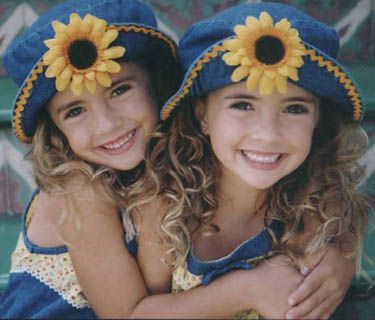 Twin girls with flower hats