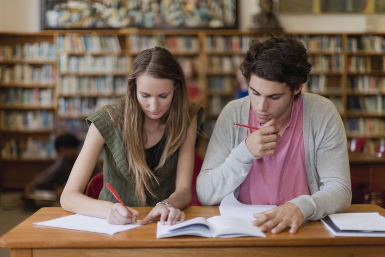 Students studying together in library