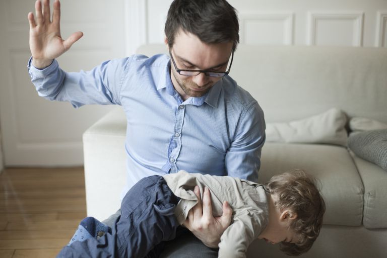 Father disciplining toddler