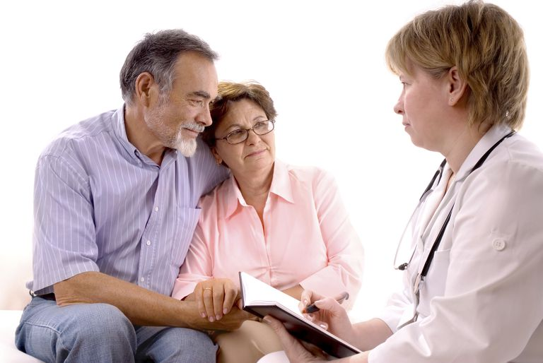 doctor talking with an elderly couple