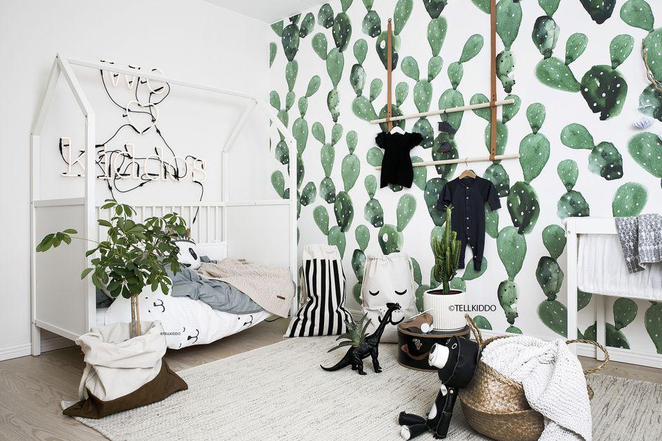 Modern nursery with bold boho cactus print