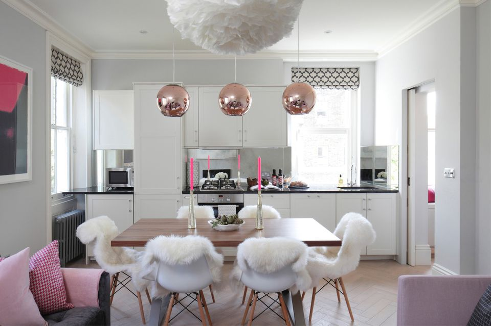 Pink and white kitchen and dining area