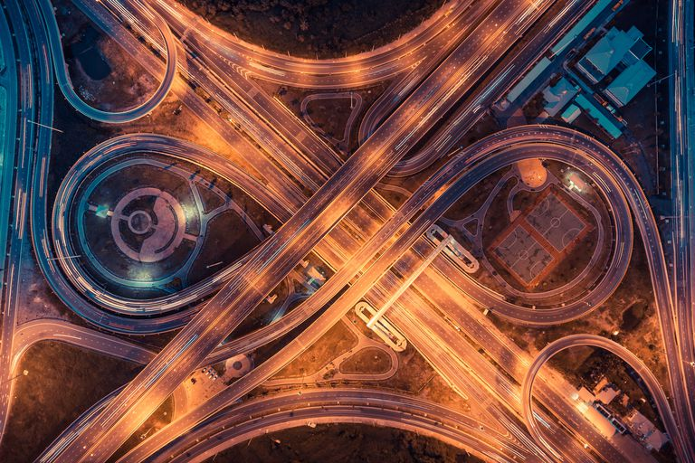 Top view of an infinity road, highway traffic and city