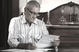 Older Man deciding if he should retire or not