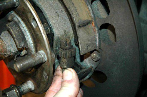 Remove the brake rotor and caliper.
