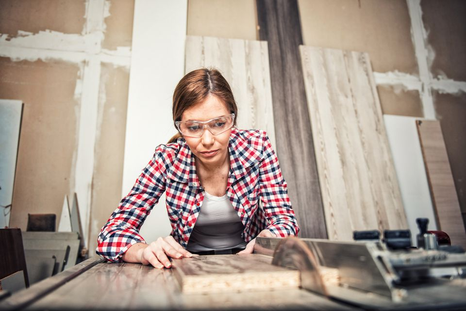 Woman using table saw