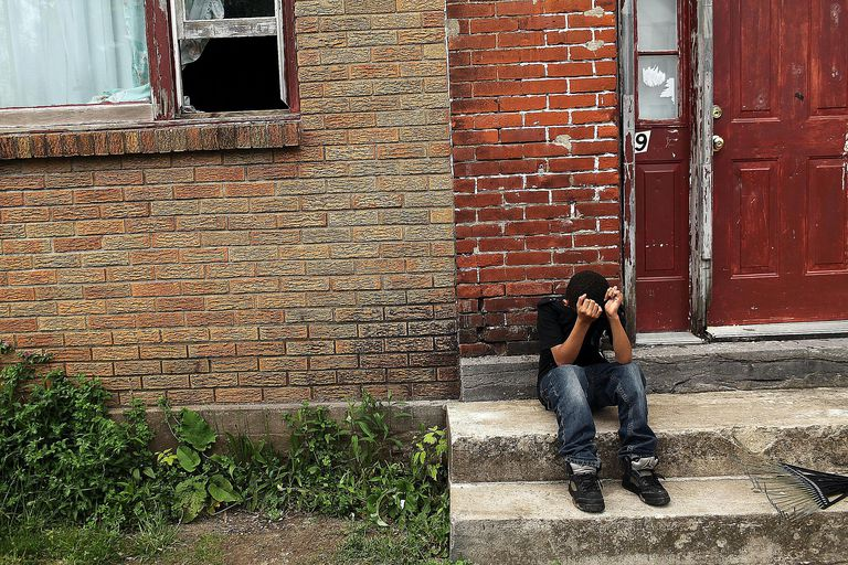 A child living in poverty in de-industrialized Utica, NY symbolizes the socio-economic causes and consequences of poverty.