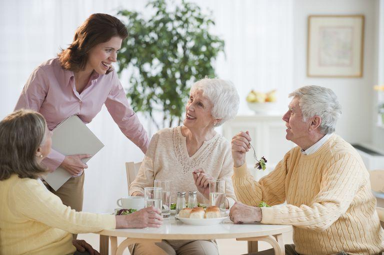 Senior adults eating dinner