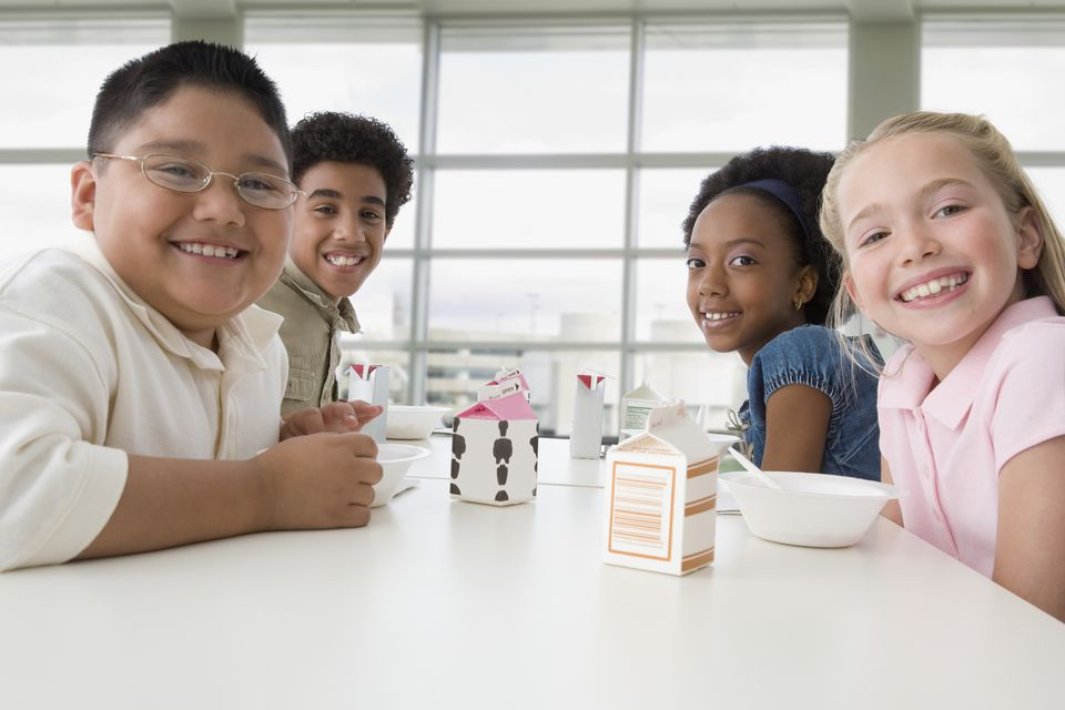 Multi-ethnic children eating in cafeteria