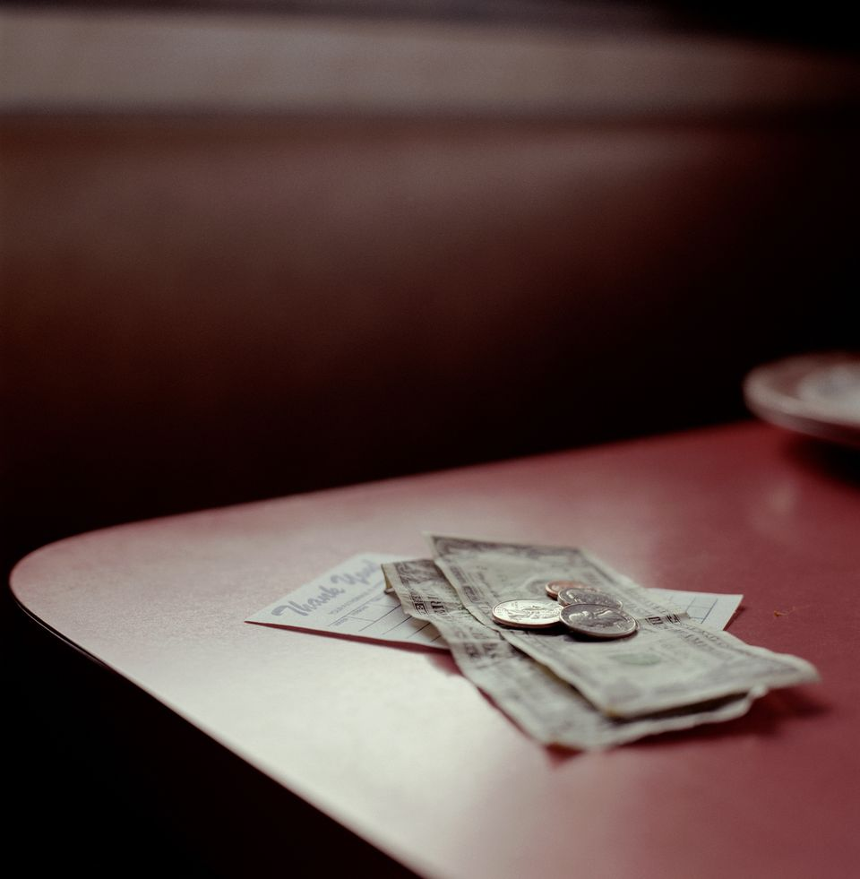 Tip and receipt on table in restaurant