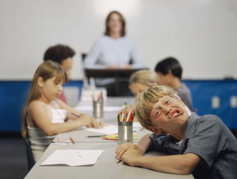 Boy with ADHD making faces in class