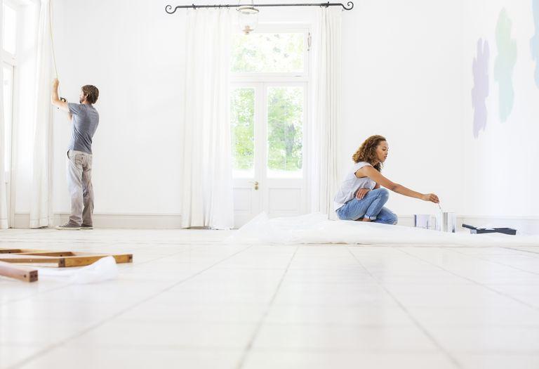 man and woman renovating house