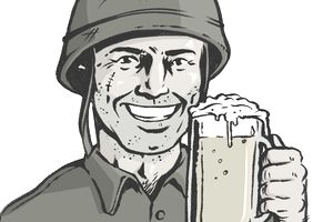 A soldier holding up a beer.
