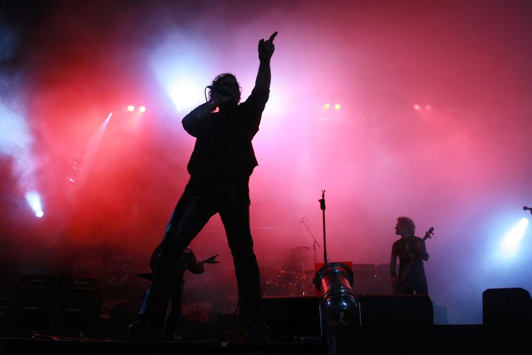 Silhouette of band performing on stage