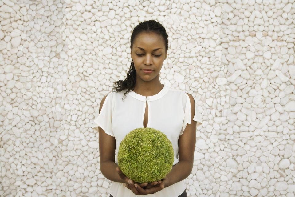 woman holding moss ball