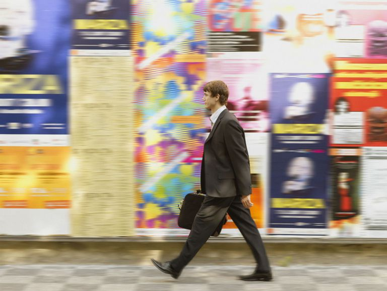 Young businessman walking on a street