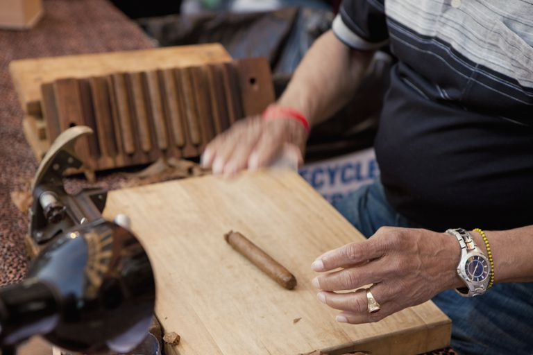 Worker at cigar factory