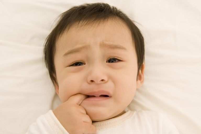 Baby boy (9-12 months) crying