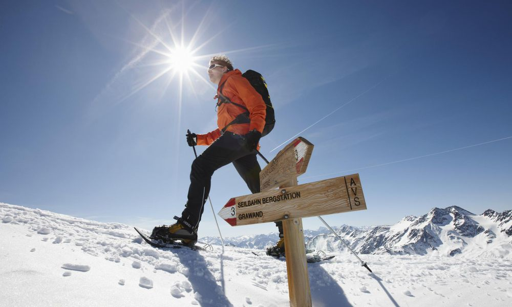 Man with snowshoes walking at Mountain Top
