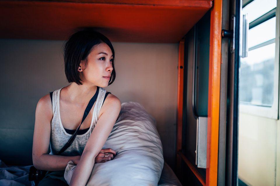 girl in sleeper car of train